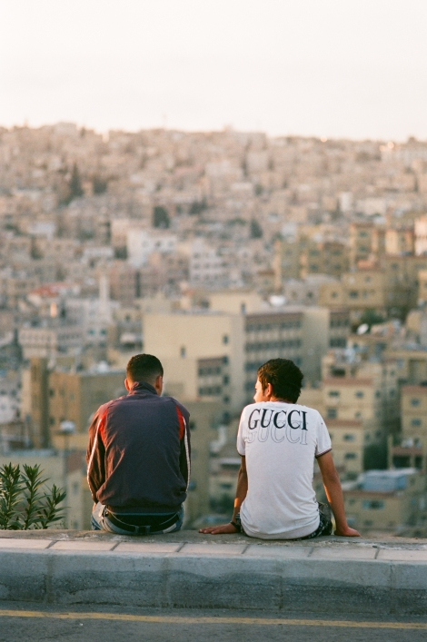 Two young Jordanian boys overlook the city of Amman (Photo: Anthony Pusatory).